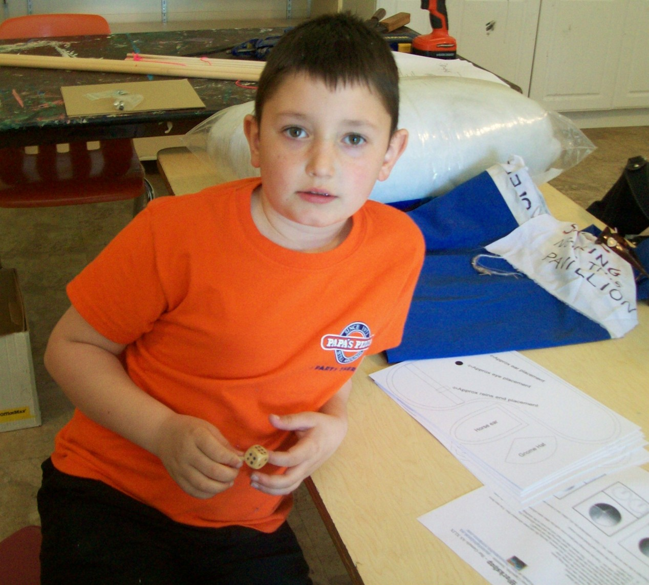 A younger student with a teetotum
